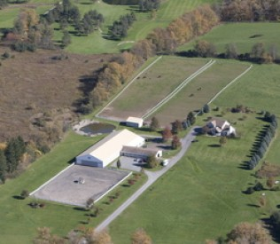 An aerial shot of the Reindance Stables with all their acres