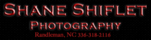 A photo of a red and black logo for Shane Shiflet photography logo